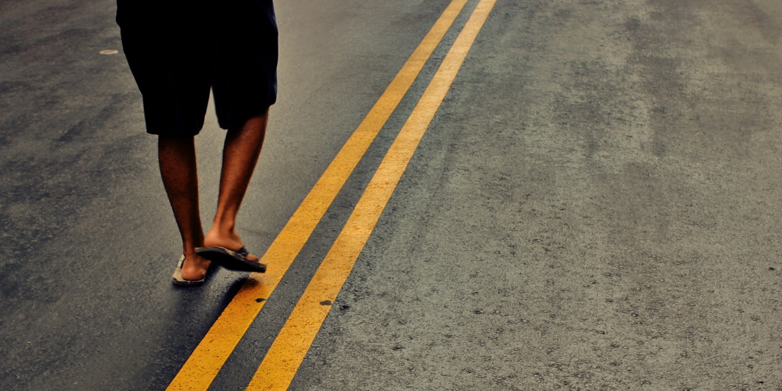 Photo of person wearing flip-flops by Nabeel Syed