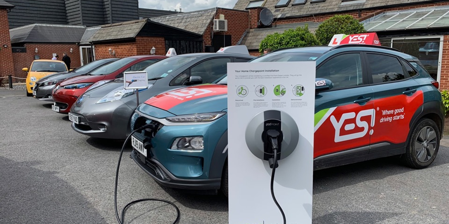 Photo of electric vehicles charging by Rob Cooling